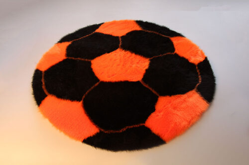 Produits finis Tapis en fourrure super douce motif football noir/orange diamètre 70 cm